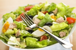 salad with tunny, egg, olive and tomato